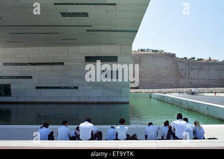 Marseille, France, group of young people sitting in the shade of MuCEM - Stock Photo