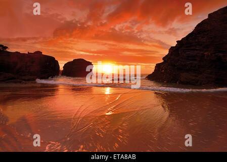 Spain, Galicia: Scenic sunset at unique beach Praia As Catedrais - Stock Photo