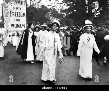 Lady Pethick-Lawrence (right) and Mrs Pankhurst lead a Suffragette demonstration, Christabel Pankhurst (in black & white) follows behind her mother. Circa 1910.
