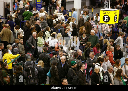 Travelers in the South terminal of London's Gatwick Airport queue to check in.Picture by James Boardman - Stock Photo