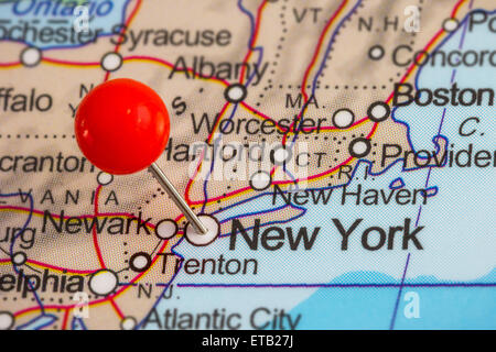 Close-up of a red pushpin in a map of New York - Stock Photo