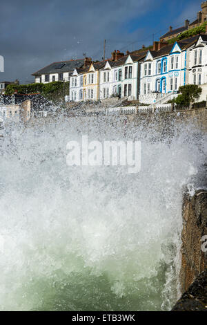 Waves crashing over the harbour wall at Porthleven, Cornwall, England, UK - Stock Photo