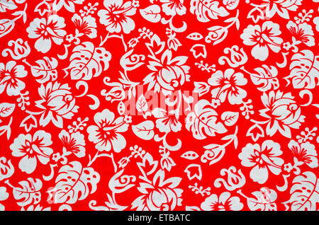 Red Hawaiian fabric with white flowers - Stock Photo