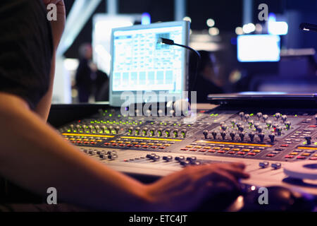 Anonymous Sound Engineer Operating Professional sound mixer at recording studios or event live coverage - Stock Photo