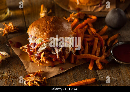 Homemade Pulled Chicken Sandwich with Coleslaw and Fries - Stock Photo