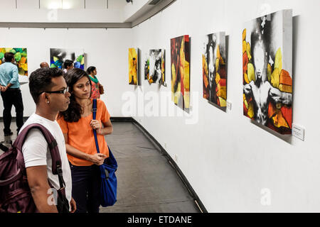 Mumbai India Indian Asian Fort Mumbai Kala Ghoda Jehangir Art Gallery contemporary paintings man woman couple looking - Stock Photo