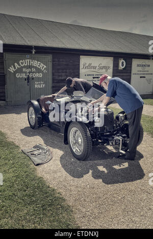 1934 Riley Ulster Imp  under going tappet adjustment in the paddock at Brooklands Museum Weybridge Surrey UK - Stock Photo