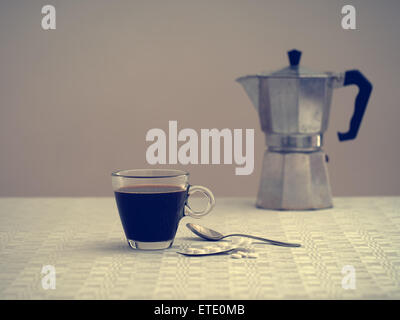 Lonely and ill - healthcare, wellbeing concept. Differential focus - old coffee maker blurry in the background. - Stock Photo