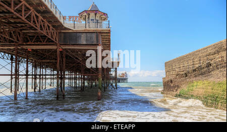 View underneath Brighton Marine Palace and Pier,  or o.k.a. Palace Pier, a pleasure pier in Brighton, East Sussex, - Stock Photo