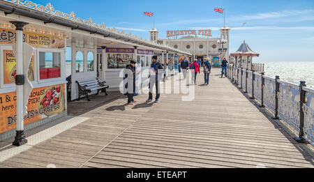 Tourists sightseeing on the famous Palace Pier, o.k.a. Brighton Pier, Brighton and Hove, East Sussex, England, UK. - Stock Photo