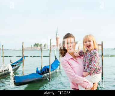 Big smiles for daddy... This little girl is thrilled to be in Venice with her parents. Gondola rides are so much - Stock Photo