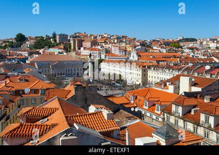 A view over the red rooftops of Lisbon city, the capital city of Portugal from the heights of the Funicular Elevador - Stock Photo
