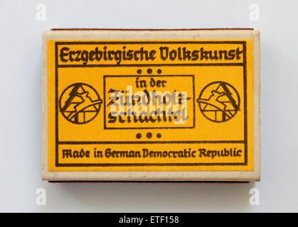 Vintage Matchbox containing hand made wood folk art toy. Erzgebirgische Volkskunst in der Zundholzschachtel - Stock Photo