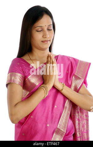 Young Indian traditional woman hands in prayer position - Stock Photo