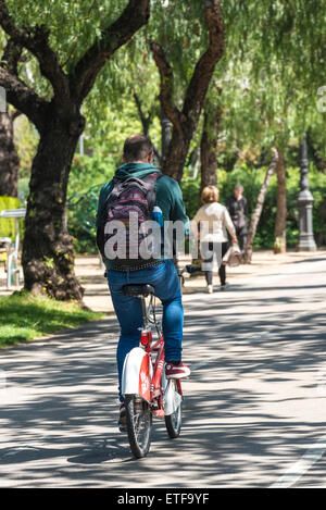 Cyclist circulating for a bike path in central Barcelona, Catalonia, Spain - Stock Photo