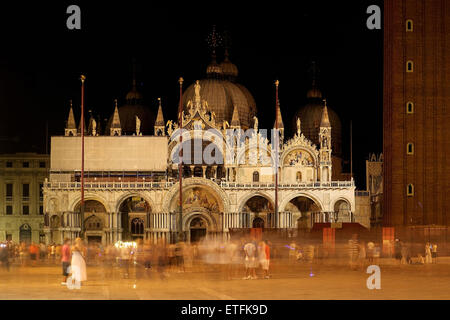 Long exposure image of the square and  basilica of Saint Mark in Venice, Italy, with motion blurred people. - Stock Photo
