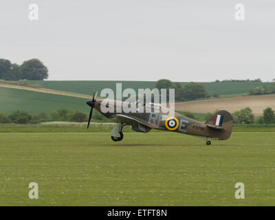 Duxford, UK - May 23rd 2015: A vintage British Hawker Hurricane fighter , landing at Duxford VE Day Airshow - Stock Photo
