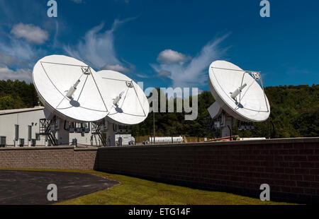 Cable TV Satellite System dishes at the Directv company in Littleton, New Hampshire, USA point to telecommunication - Stock Photo