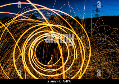Using steel wool to create a cool light trail effect using long exposure - Stock Photo