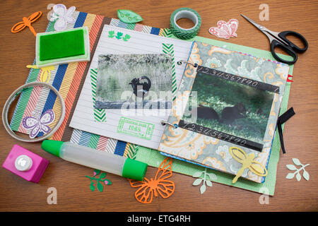 scrabook album with some of the tools used - Stock Photo