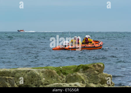 Lifeboat crew in their speedboat on sea during a search and rescue exercise - Stock Photo