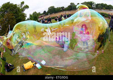 London, UK. 13th June 2015. People blowing bubbles at the LON-BUBBLE-DON International Give a Bubble Day, a bubble - Stock Photo