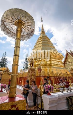 Asia. Thailand, Chiang Mai. Wat Doi Suthep. Fervent Thais being photographed in front of the effigy of King. - Stock Photo