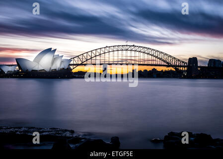 Winter sunset at the Sydney Opera House and Harbour Bridge - Stock Photo