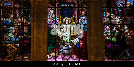 Stained glass window depicting the Child Jesus at the Temple, in the cathedral of Malaga, Spain. - Stock Photo