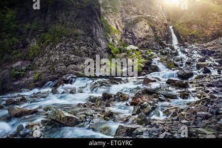 Waterfall in the mountain gorge near Almaty, Kazakhstan, Central Asia - Stock Photo