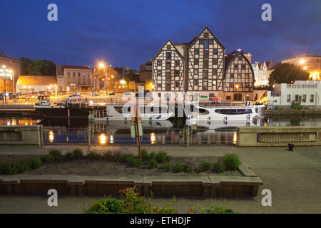 City of Bydgoszcz at night in Poland, Granaries, tour boats and waterfront along Brda River. - Stock Photo