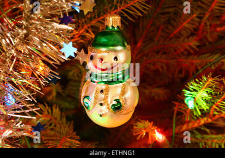 Snowman ornament hanging on the Christmas tree - Stock Photo