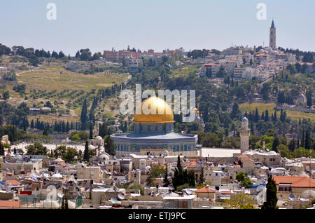 Landscape view of the Dome of the Rock Mosque on Temple Mount  against mount of Olives in Jerusalem old city, Israel. - Stock Photo
