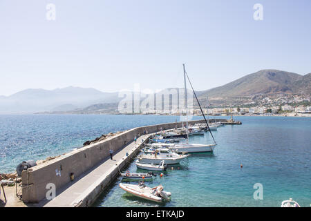 Boats lined up around the harbour in a popular tourist resort of Hersonissos in Crete. - Stock Photo