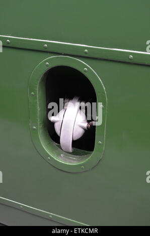Metal fuel filler cap on a vintage commercial British vehicle. - Stock Photo