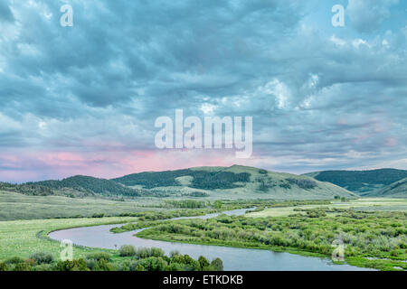 dusk over North Platte River in Colorado North park above Northgate Canyon, early summer scenery with waterfowl - Stock Photo