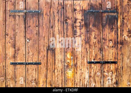 Old wooden barn antique door textured background - Stock Photo