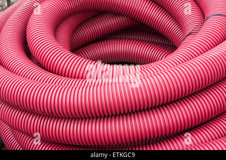 first floor of a skein of red corrugated tube - Stock Photo