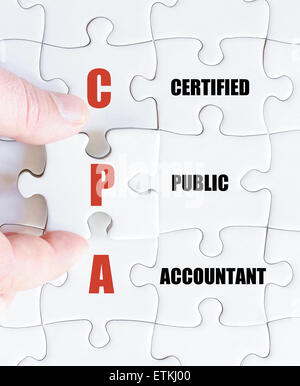 Hand of a business man completing the puzzle with the last missing piece.Concept image of Business Acronym CPA as - Stock Photo