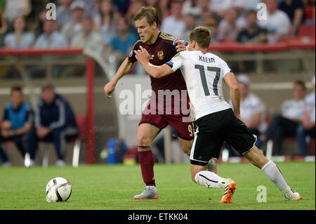 Moscow, Russia. 14th June, 2015. Alexander Kokorin (L) of Russia vies with Florian Klein of Austria during their - Stock Photo