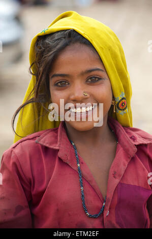 Portrait of Rajasthani girl in colourful clothing, Jaisalmer, Rajasthan, India - Stock Photo