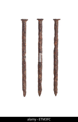 Three Old Rusty Nails on White Background - Stock Photo