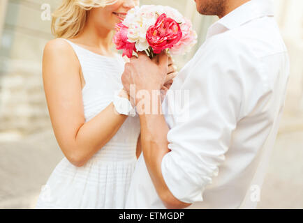 couple with flowers in the city - Stock Photo