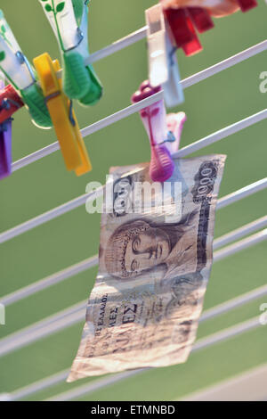 Berlin, Germany. 14th June, 2015. ILLUSTRATION - A 1000 Greek drachma bill hangs from a clothes line in Berlin, Germany, 14 June 2015. Photo: Jens Kalaene/dpa/Alamy Live News