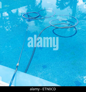 Process of cleaning swimming pool. Outdoors - Stock Photo