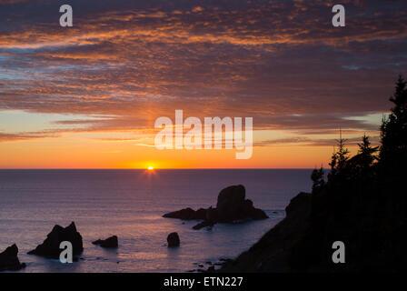 Setting Sunlight over Seastacks and Ecola State Park near Cannon Beach, Oregon, USA - Stock Photo