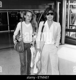 Mick Jagger and girlfriend, model, Jerry Hall, pictured at London Heathrow Airport, departing for India, 28th July - Stock Photo