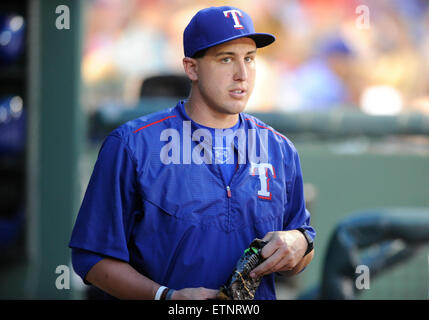 JUN 12, 2015: Texas Rangers starting pitcher Derek Holland #45 on the disabled list in the dugout during an MLB - Stock Photo