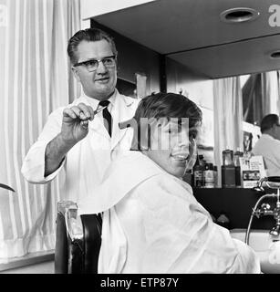 Peter Noone, lead singer of British pop group Herman Hermits, pictured visiting Mike Skotny's  barber shop straight - Stock Photo