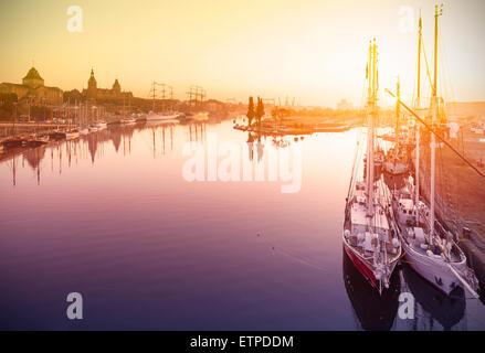 Beautiful sunrise over harbor, waterfront in Szczecin, Poland. - Stock Photo